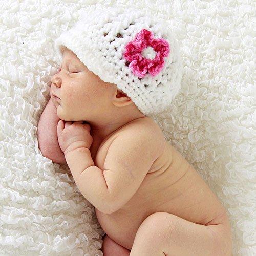 bebe661-4-bebe-con-gorrito-de-flor-durmiendo